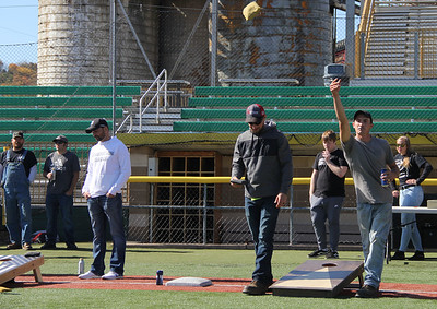 0662: Matt Sheppeck, left, tosses a cornhole bag on Saturday at Pullman Park. Photo by Eric Jankiewicz.