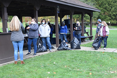 Volunteers for Bundle Up Butler wait at a shelterfilled with coats in Butler Memorial Park on Oct. 16, 2020 for county residents to drive up to the coat pick-up area. People needing coats would drive up and a bag would be placed in their cars.  Photo by Lauryn Halahurich/Butler Eagle