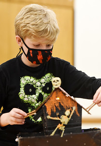 Joel Shaffer, 10, of West Sunbury puts the finishing touches on his robotics haunted house at the Slippery Rock Twp. Community Center Monday, October 19, 2020. Harold Aughton/Butler Eagle
