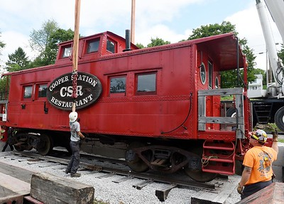 Harold Aughton/Butler Eagle: The little red caboose from Cooper Station made its way to its new home in Cabot along side the Buffalo bike trail Friday, Septemeber 11, 2020.