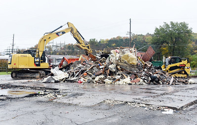 Workers from White Oak Construction from Indianapolis, Indiana remove debris from the Pizza Hut on Route 8 in Butler Twp. Tuesday, October, 20, 2020. Harold Aughton/Butler Eagle