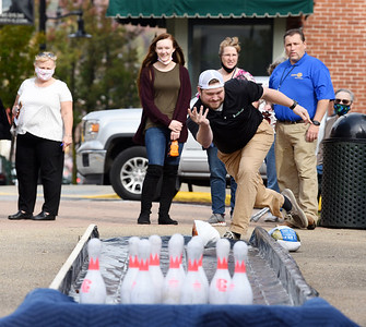 Logan Maxwell, co-owner of the Germinator, takes aim during the Butler Rotary's turkey bowl fundraiser to raise money to eradicate polio in Diamond Park, Wednesday, October 21, 2020. Harold Aughton/Butler Eagle.