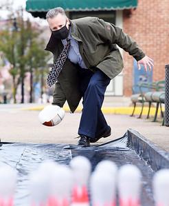 Mark Buchek of Northwest Bank takes aim during the Butler Rotary's turkey bowl fundraiser to raise money to eradicate polio. Harold Aughton/Butler Eagle.