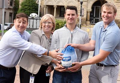 From left: Steven Green, Leslie Osche, Mark Edwards, and Jordan Grady helped raise funds for the Butler Rotary's Turkey Bowl in Diamond Park, Wednesday, October 21, 2020.