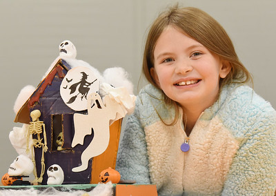 London Donaldson, 9, of North Washington shows off the robotics haunted house she made as part of a six week course put on by Kid's Innovation Playground. The haunted house came equipped with LED lights, sensors and servo motors. Harold Aughton/Butler Eagle