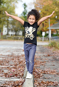 Dalia Contreras, 5, of Mars practices her gymnasitcs by balancing herself in the parking lot of Roebling Park in Saxonburg Wednesday, October 21, 2020. Dalia was at the park with her mother Elizabeth Contreras and brother, Daniel, 2. Harold Aughton/Butler Eagle