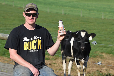 """William Thiele holds up a bottle of Marburger choclate milk that displays the """"Sell by"""" date. Harold Aughton/Butler Eagle"""