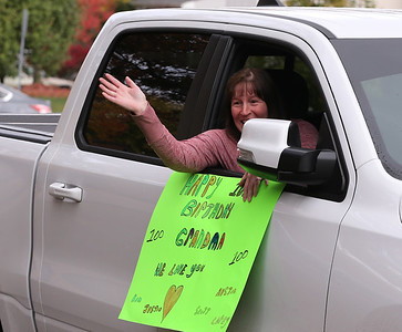 Madeleine Samarco's grand-daugher-in-law Kim Samarco waves with family during Madeleine's 100th birthday parade. Seb Foltz/Butler Eagle 10/24/20