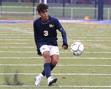 Mars midfielder Gabriel Singh takes a direct kick during the Planets home playoff win againts Laurel Highlands Saturday. Seb Foltz/Butler Eagle 10/24/20