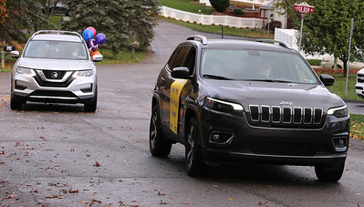 Madeleine Samarco 100th birthday drive-by parade Saturday in Cranberry. Samarco sat in a vehicle while a line of cars passed waving and delivering gifts. Seb Foltz/Butler Eagle. 10/24/20