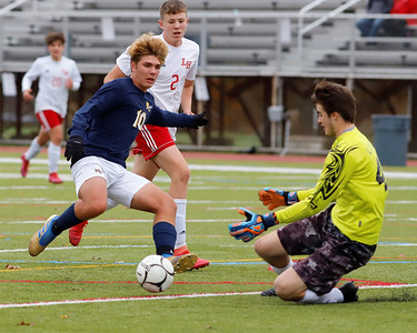 Mars midfielder Eli Wright (10) attempts to get a shot off against Laurel Highlands goalie Zach Layton (40) in the Planets opening round home playoff win Saturday. Seb Foltz/Butler Eagle 10/26/30