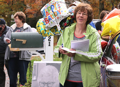 Barb Bjalobok celebrates her mother Madeleine Samarco's 100th birthday Saturday in Cranberry. Family and friends took part in a drive-by birthday parade while Samarco sat in a car on her driveway. Seb Foltz/Butler Eagle 10/24/20
