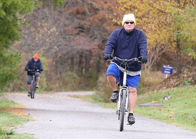 Michael Mihalich of Freeport cruises the Butler Freeport trail Saturday with his wife Sharon. Seb Foltz/Butler Eagle 10/24/20