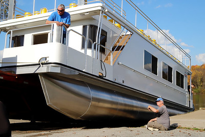 Moraine Preservation Fund volunteers guide the group's new pontoon boat down the McDanels Boat Launch at Moraine State Park. The boat hit the water for the first time Thursday, but won't begin public tours until spring. Sebastian Foltz/Butler Eagle 10/23/20