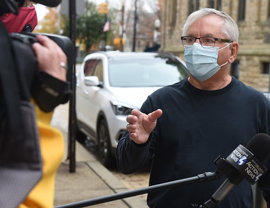 Vietnam Veteran Al Boehm of Cranberry Twp. explains to a Pittsburgh reporter why he drove to Butler to cast his vote. Harold Aughton/Butler Eagle.