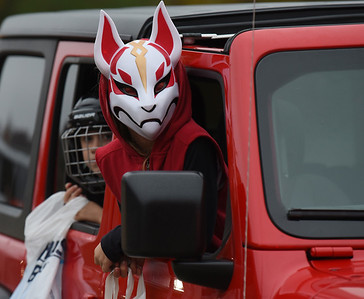 Maddox, 6, and Brecklyn Munshower,8, who dressed as Drift from Fortnight for the trick or treat drive-through at the Mars Elementary School. Harold Aughton/Butler Eagle