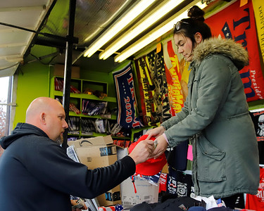 Kevin O'Donnell, 42, buys a hat from Madison Nicolazzo, 20, at her family's Trump merchandise stand on Route 228 in Cranberry. Nicolazzo said her family began selling Trump novelties because of Covid-19's  impact on their regular small businesses. Her family owns a number of vape shops and traveling amusement park features. Seb Foltz/Butler Eagle 10/29/20