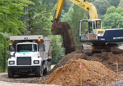 Harold Aughton/Butler Eagle: Workers from Gregor Contracting of Renfrew remove topsoil at the entrance of the park to make way for a new parking lot. Contractors are also installing new water and sewer lines as well as new restrooms.