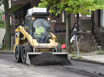 Harold Aughton/Butler Eagle: Workers from Shields Paving prpeare South Washington Street for paving Wednesday, September 2, 2020.