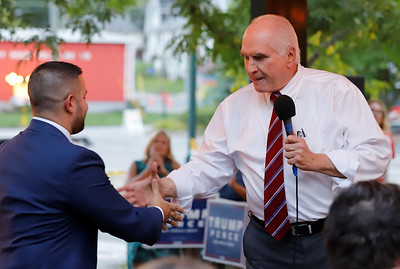 Rep. Mike Kelly shakes hands with Slippery Rock Mayor Jondavid Longo at Wednesday's opening of the northern Butler Republican campaign office in Slippery Rock. Kelly was an unannounced special guest. Seb Foltz/Butler Eagle 09/02/20
