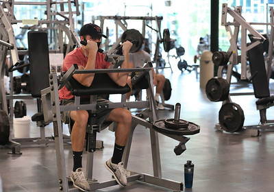 A Robert N. Aebersold Student Rec Center user works out Friday at Slippery Rock University. University officials have moved some workout equipment into one of the center's basketball courts in order to accomodate social distancing requirements. Seb Foltz/Butler Eagle 09/04/20