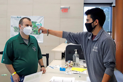 Slippery Rock University staff member Nicolas Mundo gets his temperature checked by Jacob Martin in the Robert M. Smith Student Center Friday. Seb Foltz/Butler Eagle 09/04/20