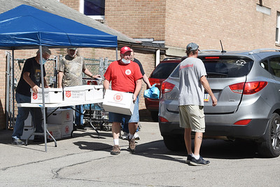 Harold Aughton/Butler Eagle: Captain Dave Means of the Salvation Army registers clients for the food distribution Friday, September 4, 2020.