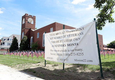 St. Peter's Reformed Church in Zelienople and veteran's awareness charity Mission 22 display 660 small American Flags representing the average number of veterans that die from suicide each month in the United States. Seb Foltz/Butle Eagle