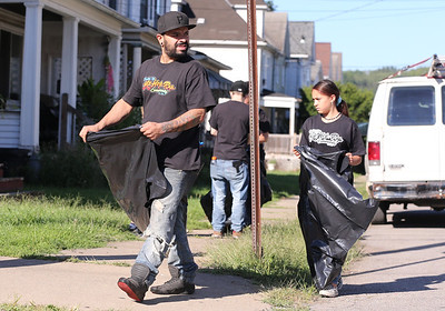 Butler Hip Hop Community founder Everett B. Roy, 33, of Saxonburg picks up  trash Saturday in Butler's Island neighborhood with his dauter Aubrey Jo Roy, 12. Roy and other volunteers spend every Saturday at a different part of Butler collecting trash. Seb Foltz/Butler Eagle Sept. 5 2020