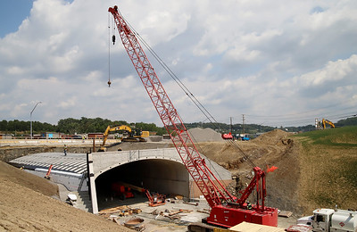 Construction crews continue work on the MSA Thruway project in Cranberry Tuesday. Crews have begun building the initial framework of the tunnel that will run from Interstate 79 under Highway 228. Seb Foltz/Butler Eagle 08/25/20