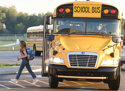Harold Aughton/Butler Eagle: Students exit the bus one at a time at the during the first day of school at the Mars Middle School.