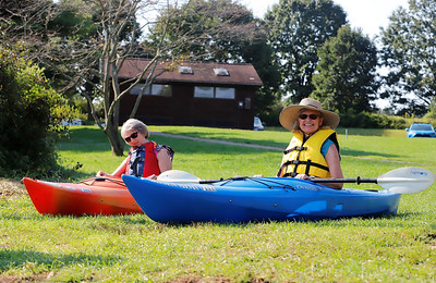 Gayle Lenihan(left) of Grove City and Ruth Fertelmes of Cabot test kayaks Wednesday before a tour of Lake Arthur with environmental education staff at Moraine State Park. Seb Foltz/Butler Eagle 09/09/20