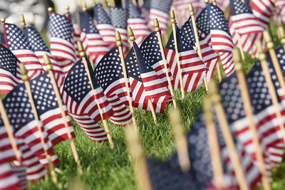 Harold Aughton/Butler Eagle: Volunteers from Mars placed 2,977 flags representing those who died in 911 in front of the Mars High School Thursday, September 10, 2020.