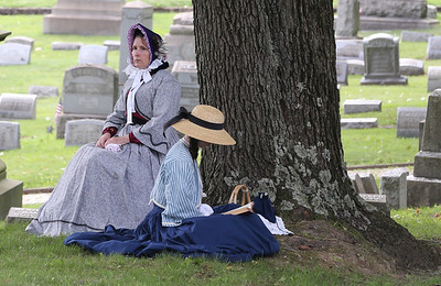 Maggie Reimers(right) and Angela Bachman of Prospect serve as Civil War era reenactors during Saturday's Echoes From Our Past Historic Cemetary Walk at North Side Cemetery. Seb Foltz/Butler Eagle 09/12/20