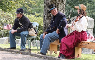 Caelan Hinterlang of Saxonburg(left), Steve and Rose Boley serve as Civil War reenactors during Saturday's Echoes From Our Past Historic Cemetary Walk at North Side Cemetery. Seb Foltz/Butler Eagle 09/12/20