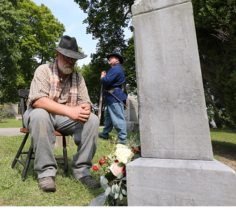 Paul Sutliff acts as an elder John McMasters mourning a family death while Chad Slater tells the story as a younger McMasters during Saturday's Echoes From Our Past Historic Cemetary Walk at North Side Cemetery. McMasters was Civil War Soldier from Butler, buried at the cemetary. Seb Foltz/Butler Eagle 09/12/20