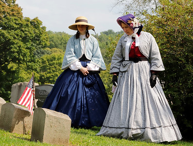 Maggie Reimers(left) and Angela Bachman of Prospect serve as Civil War era reenactors mourning during Saturday's Echoes From Our Past Historic Cemetary Walk at North Side Cemetery. Seb Foltz/Butler Eagle 09/12/20