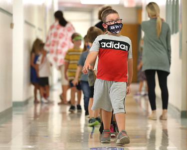 Parker Carol leads his kindergarten class down the hall after recess at Northwest Elementary School Tuesday. Seb Foltz/Butler Eagle 09/08/20