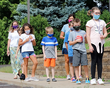 Norhwest Elementary School third graders walk single file to go out for recess Tuesday. Seb Foltz/Butler Eagle 09/08/20