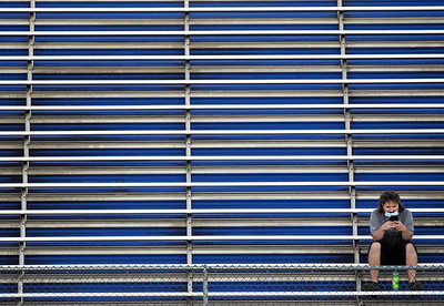 Harold Aughton/Butler Eagle: Only one spectator sat in the visiting team's bleachers between Knoch Knights and the Highlands Rams Friday, September 11, 2020.