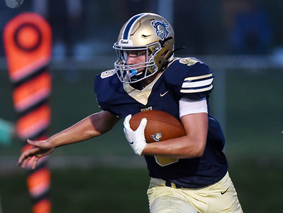 Harold Aughton/Butler Eagle: Knoch runningback #9 looks to turn it up field in the second quarter.