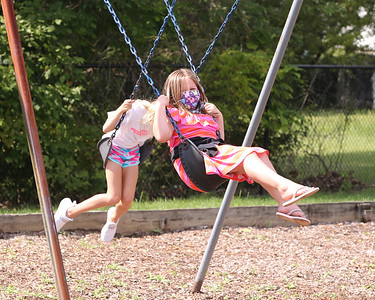 Northwest Elementary School third graderAdelee Froilan swings with a classmate during recess Tuesday. Seb Foltz/Butler Eagle 09/08/20