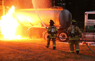 Fire fighters practice putting out a simulated truck fire at the Butler County Community College fire training center during a training class Wednesday. Seb Foltz/Butler Eagle 09/17/20