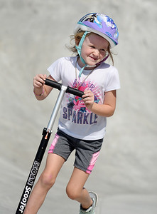 Leila Davis, 5, a kindergartner at Connoquennessing Valley Elementary, spent Tuesday afternoon riding her scooter at the Zelienople Community Park with her mother Jenna Davis of Zelienople. Harold Aughton/Butler Eagle