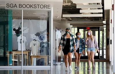 Slippery Rock University juniors Jena Reinheimer, Andrea Malacaman and Jessica Lascher walk through the  Robert M. Smith Student Center Friday. Seb Foltz/Butler Eagle 09/04/20