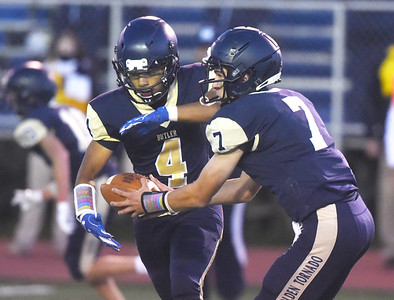 Harold Aughton/Butler Eagle: Butler's Cooper Baxter, #7, hands off to running back #4 in the second quarter of Friday nights game agianst Erie-McDowell.