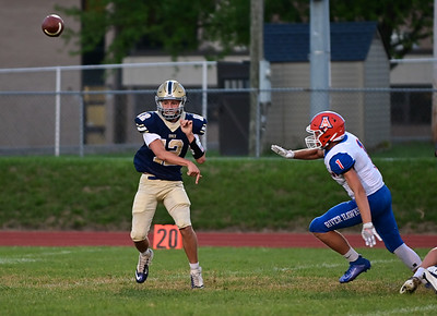 Knoch #12 J.J. Szebalskie throws a side pass during a game verses Armstrong at Knoch Stadium on Friday September 25, 2020 (Jason Swanson photo)