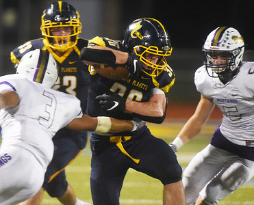 Mars Teddy Ruffner breaks a tackle in the second quarter. Harold Aughton/Butler Eagle