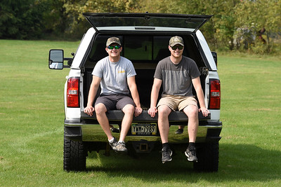Hunter Lefever of Connoquenessing Twp., left, and his hunting buddy, Dan Toomey of Herman, had their hunting equipment stolen out of the back of Lefever's white pickup truck while on a hunting trip to Wyoming. Harold Aughton/Butler Eagle