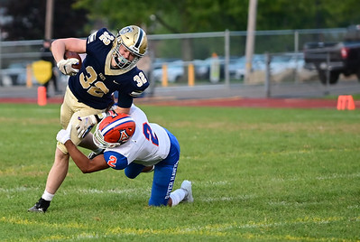 Knoch #32 Tyler Buterbaugh is tackled by Armstrong #2 Cole Brown during a game at Knoch Stadium on Friday September 25, 2020 (Jason Swanson photo)